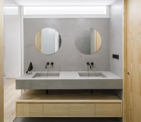 The double sink in the main bathroom is generated through a continuous concrete surface with no joints.   | credits: Imagen Subliminal